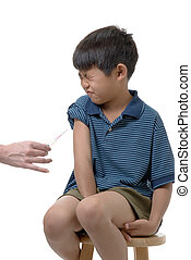 It\\\'s going to hurt - Young boy about to get immunized