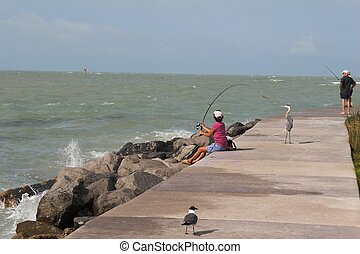 woman fishing on local pier in florida