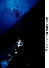 Diver Below Wreck