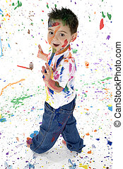 Little Artist - Adorable 3 year old boy covered in bright...