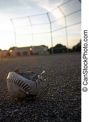 Smashed - A softball that has been cracked open on a...