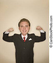 Business power pose 2 - Business man in black suit, red tie,...