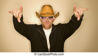 Cowboy with hands up - Cowboy wearing a cowboy hat with his...