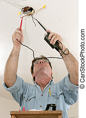 Electrician Testing Voltage - An electrician testing the...