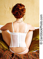 Young woman in corset - Woman in corset from the back