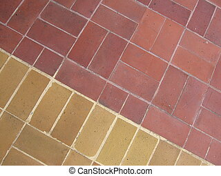 Red Bricks, Beige Bricks - Red bricks meet beige bricks on a...