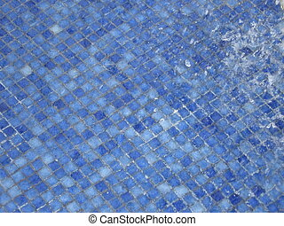 Splash in Blue Tile - Splashes in a blue mosaic tile pool