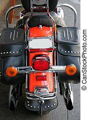 Motorcycle - Hind view of a red motorcycle with leather bags