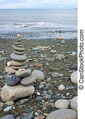 Beach Shrine - cleverly balanced stack of smooth stones on a...