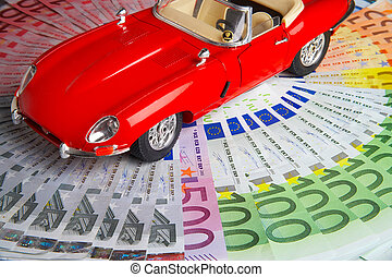 high-class - model of a car lying on the circle of money