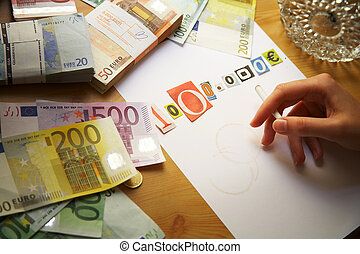 million Euro - Hand is writing a blackmail and money is...