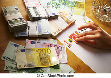 financial crisis - Hand is writing a blackmail and money is...