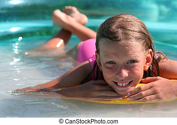 In the swimming pool - Young girl in the swimming pool