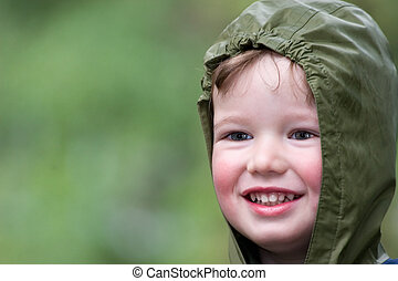 Rainy day - Cheerful child on walk in rainy day