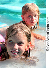 In the swimming pool - Two girls in the swimming pool