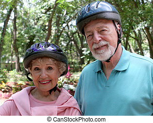 Active Senior Couple - An attractive senior couple wearing...