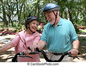Seniors Fitness - A happy senior couple staying fit by...
