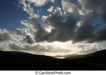 harris skyscape - Sculpted clouds over the landscape of...