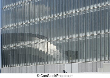 corporate texture - A titanium building is reflected in the...