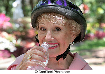 Senior Fitness Hydration - A senior lady hydrating herself...
