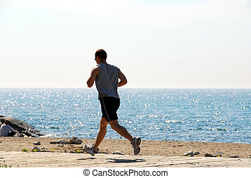 Man jogging in a beach