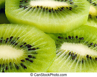 Slices of kiwi fruit - Close-up of fresh cut sliced kiwi...