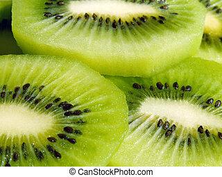 Slices of kiwi fruit - Close-up of fresh cut sliced kiwi...