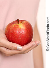 Have an apple - A woman holding an apple