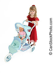 Child with Baby Doll - Pretty little 5 year old girl pushing...
