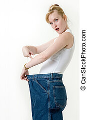 Can you believe this? - Woman demonstrating weight loss by...