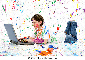 Teen With Laptop - Beautiful teen girl covered in paint with...