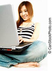 Asian girl with laptop - A young beautiful asian women...