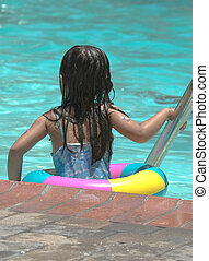 Little girl in the pool - Little girl playing in the...