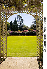 Pergola - View of a beautiful garden from under a pergoll