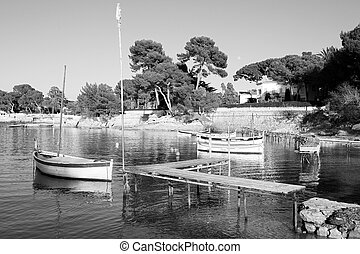 Antibes #251 - A yacht floating in Antibes, France. Black...