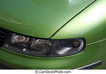Car headlight - Front headlight of a green sports car