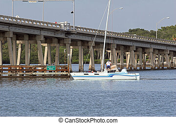 sailboat - Draw bridge at gulf of mexico in florida opening...