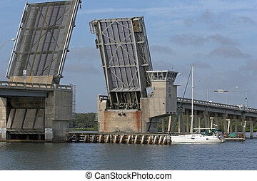 draw bridge and sailboat - Draw bridge at gulf of mexico in...