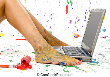 Paint Splash - Woman\\\'s foot on laptop. Surounded by...