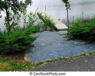 boat dock - big stone path leading to a boat dock