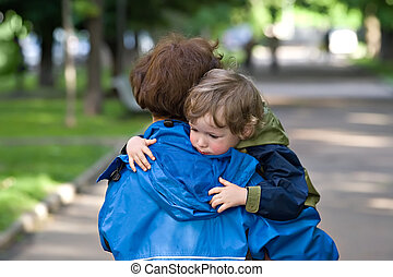 Mum carries the kid - Mother carries the tired kid from walk
