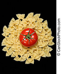 Pasta and tomato - Farfalle pasta and red tomato.