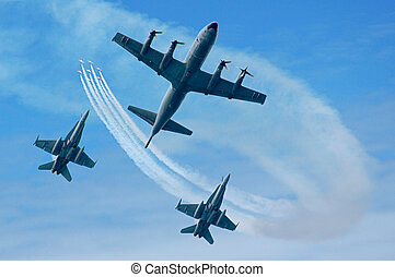 Air show - P-3 Orion and two F-18 airplanes This photo is...
