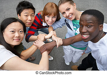 we are friends - young people of different ethnic groups on...