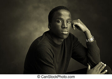 unhappy b/w - portrait of a young black man thinking