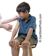Ouch - Young boy about to get immunized
