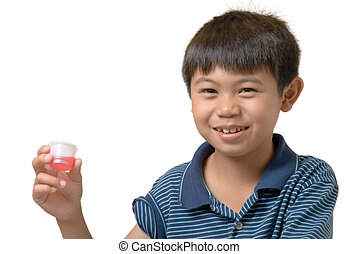 You want me to drink this? - Cute boy holding up some pink...