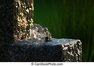 water fountain - garden fountain in evening sun