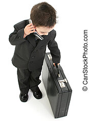 On The Go - Little business man with cellphone and...