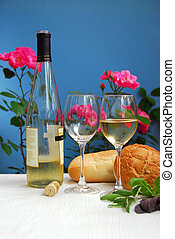 White wine with glasses on blue background
